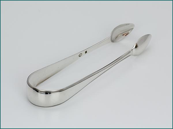 Zilveren klontjestang uit 1835-0